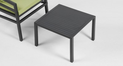 Aria-Coffee-Table-60-in-Charcoal-Pictured-in-Showroom-with-Aria-Chair